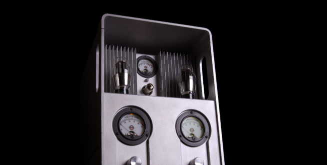 Grey tube amplifier with a black background.